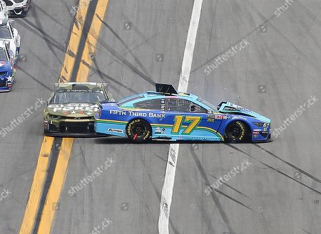 Ricky Stenhouse Jr., right, gets turned sideways as Kurt Busch, left, makes contact as the cars come out of turn 4 during the NASCAR Cup Series auto race at Daytona International Speedway, in Daytona Beach, Fla. Both drivers were able to continue with the race