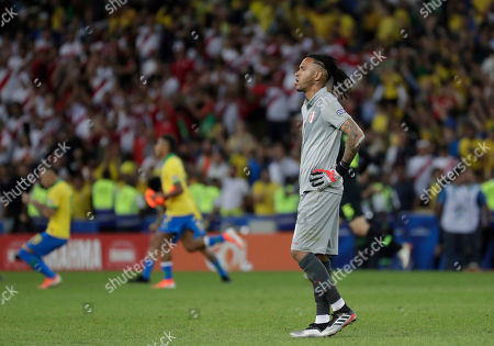 Peru's goalkeeper Pedro Gallese stands on the field after his team lost 3-1 to Brazil at the end of the final Copa America soccer match at Maracana stadium in Rio de Janeiro, Brazil