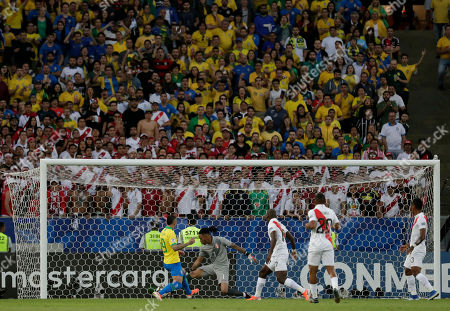 Brazil's Everton, left, scores his side's opening goal past Peru's goalkeeper Pedro Gallese during the final match of the Copa America at Maracana stadium in Rio de Janeiro, Brazil