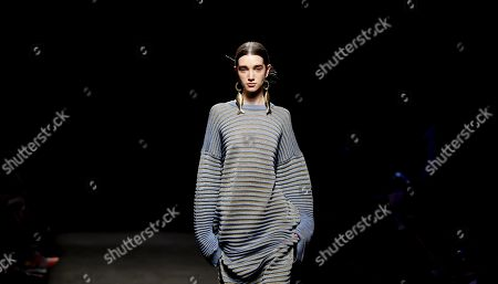A model presents a creation from the Spring-Summer 2020 collection by Spanish designer Juan Vidal during a fashion show during the 70th Mercedes-Benz Fashion Week Madrid, in Madrid, Spain, 07 July 2019. The MBFWM runs from 05 to 10 July.