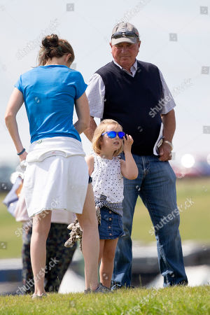 Mia Grace Tindall with her grandfather Captain Mark Phillips watch as Zara Tindall competes at the Barbury International Horse trials.