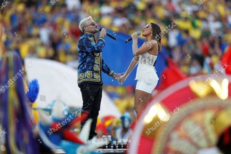 Brazilian singer Anitta (R) and Puerto Rican singer Pedro Capo perform during the Copa America 2019 final soccer match between Brazil and Peru, at Maracana Stadium in Rio de Janeiro, Brazil, 07 July 2019.