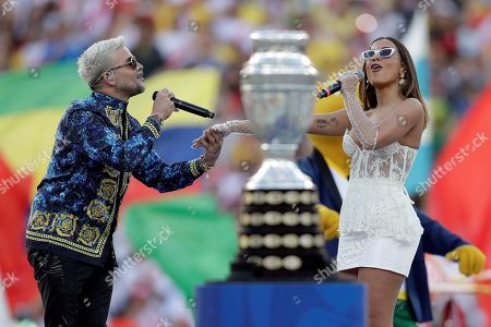 Puerto Rican singer Pedro Capo (L) and Brazilian singer Anitta (R) perform during the closing ceremony of the Copa America 2019 before the final soccer match between Brazil and Peru, at Maracana Stadium in Rio de Janeiro, Brazil, 07 July 2019.