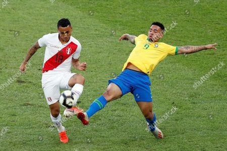 Brazilian Gabriel Jesus vies for the ball with Peruvian Yoshimar Yotun (L), during the Copa America 2019 final soccer match between Brazil and Peru, at Maracana Stadium in Rio de Janeiro, Brazil, 07 July 2019.