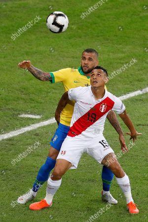 Brazilian Dani Alves (back) vies for the ball with Peruvian Yoshimar Yotun, during the Copa America 2019 final soccer match between Brazil and Peru, at Maracana Stadium in Rio de Janeiro, Brazil, 07 July 2019.