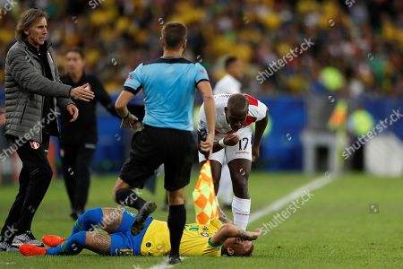 Peru's Luis Advincula (up) and Brazil's Everton (down) during the Copa America 2019 final soccer match between Brazil and Peru, at Maracana Stadium in Rio de Janeiro, Brazil, 07 July 2019.