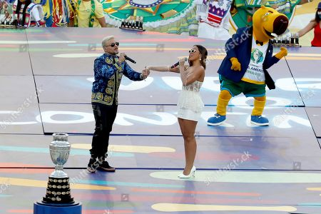 Puerto Rican singer Pedro Capo (L) and Brazilian singer Anitta (R) perform during the closing ceremony of the Copa America 2019, before the final soccer match between Brazil and Peru, at Maracana Stadium in Rio de Janeiro, Brazil, 07 July 2019.