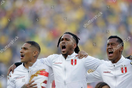 Peru's Paolo Guerrero, left, goalkeeper Pedro Gallese, center, and Renato Tapia sing their national anthem prior to the final match of the Copa America against Brazil at the Maracana stadium in Rio de Janeiro, Brazil