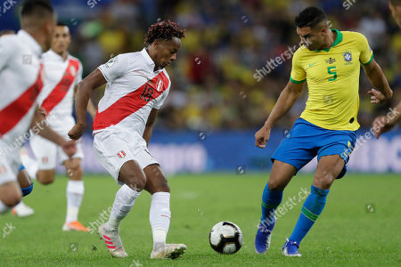 Peru's Andre Carrillo, left, and Brazil's Casemiro go for the ball during the final match of the Copa America at the Maracana stadium in Rio de Janeiro, Brazil