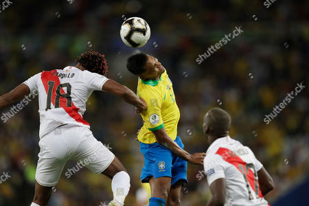 Brazil's Alex Sandro, center, heads the ball next to Peru's Andre Carrillo, left, during the final match of the Copa America at the Maracana stadium in Rio de Janeiro, Brazil