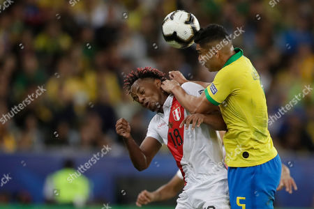 Brazil's Casemiro, right, and Peru's Andre Carrillo fight for the ball during the final match of the Copa America at the Maracana stadium in Rio de Janeiro, Brazil