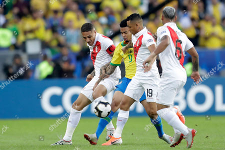 Brazil's Gabriel Jesus, second from left, competes for the ball with Peru's Paolo Guerrero, left, and Peru's Yoshimar Yotun during the final match of the Copa America at the Maracana stadium in Rio de Janeiro, Brazil