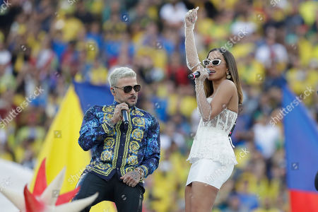 Anitta, right, and Pedro Capo sing prior to the final soccer match of the Copa America between Brazil and Peru at the Maracana stadium in Rio de Janeiro, Brazil
