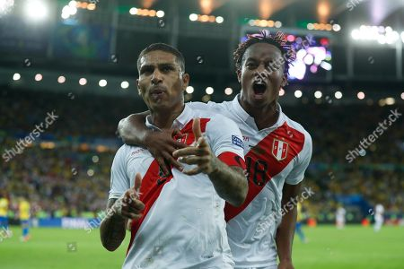 Peru's Paolo Guerrero celebrates with teammate Andre Carrillo, right, after scoring a penalty kick against Brazil during the final soccer match of the Copa America at the Maracana stadium in Rio de Janeiro, Brazil