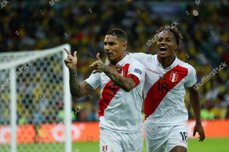 Peru's Paolo Guerrero celebrates with teammate Andre Carrillo, right, after scoring his side first goal against Brazil during the final soccer match of the Copa America at the Maracana stadium in Rio de Janeiro, Brazil