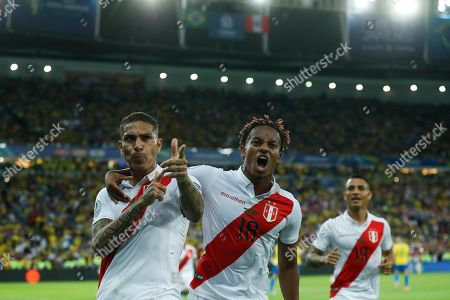 Peru's Paolo Guerrero celebrates with teammate Andre Carrillo, center, after scoring his side first goal against Brazil during the final soccer match of the Copa America at the Maracana stadium in Rio de Janeiro, Brazil