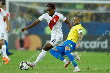 Brazil's Dani Alves fights for the ball with Peru's Andre Carrillo during the final soccer match of the Copa America at the Maracana stadium in Rio de Janeiro, Brazil