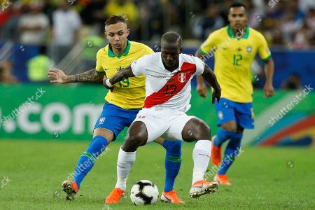 Peru's Luis Advincula fights for the ball with Brazil's Everton during the final soccer match of the Copa America at the Maracana stadium in Rio de Janeiro, Brazil