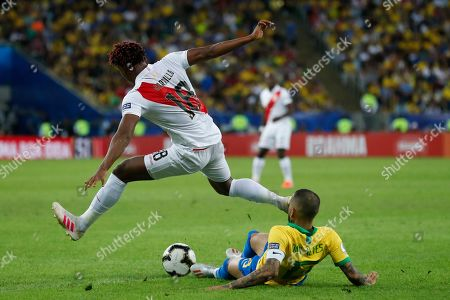 Peru's Andre Carrillo fights for the ball with Brazil's Dani Alves during the final soccer match of the Copa America at the Maracana stadium in Rio de Janeiro, Brazil