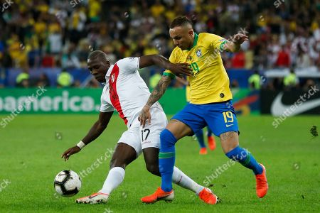 Peru's Luis Advincula, left, fights for the ball with Brazil's Everton during the final soccer match of the Copa America at the Maracana stadium in Rio de Janeiro, Brazil