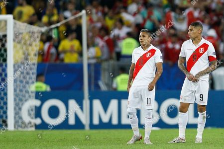 Peru's Raul Ruidiaz and Peru's Paolo Guerrero, right, react after loosing 1-3 the final soccer match of the Copa America at the Maracana stadium in Rio de Janeiro, Brazil