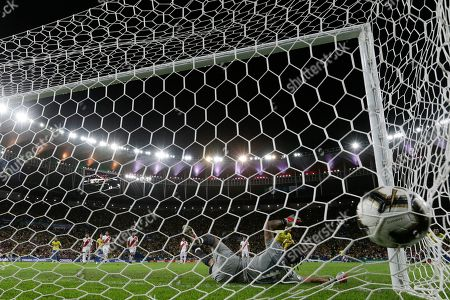Peru's goalkeeper Pedro Gallese fails to stop a penalty kick by Brazil's Richarlison during the final soccer match of the Copa America at the Maracana stadium in Rio de Janeiro, Brazil