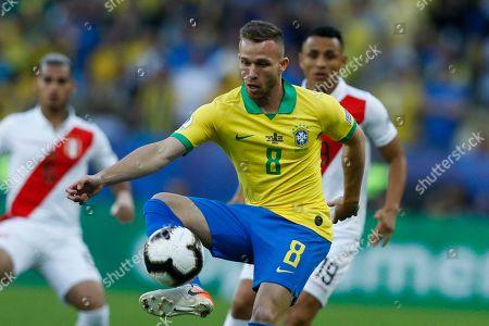 Brazil's Arthur controls the ball ahead of Peru's Yoshimar Yotun during the final soccer match of the Copa America at the Maracana stadium in Rio de Janeiro, Brazil