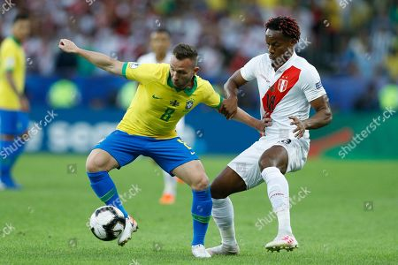 Brazil's Arthur controls the ball challenged by Peru's Andre Carrillo during the final soccer match of the Copa America at the Maracana stadium in Rio de Janeiro, Brazil