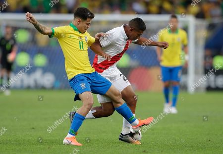 Brazil's Philippe Coutinho, left, fights for the ball with Peru's Edison Flores during the final match of the Copa America at Maracana stadium in Rio de Janeiro, Brazil
