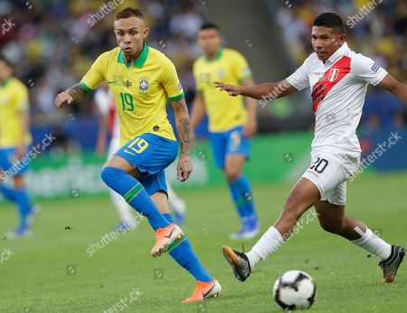 Brazil's Everton, left, fights for the ball with Peru's Edison Flores during the final match of the Copa America at Maracana stadium in Rio de Janeiro, Brazil
