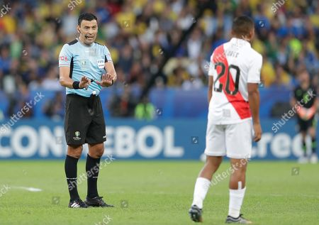 Referee Roberto Tobar admonished Peru's Edison Flores during the final match of the Copa America against Brazil at Maracana stadium in Rio de Janeiro, Brazil
