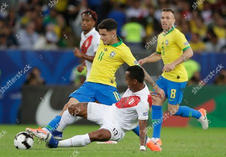 Peru's Renato Tapia, right, sweeps Brazil's Philippe Coutinho during the final match of the Copa America at Maracana stadium in Rio de Janeiro, Brazil