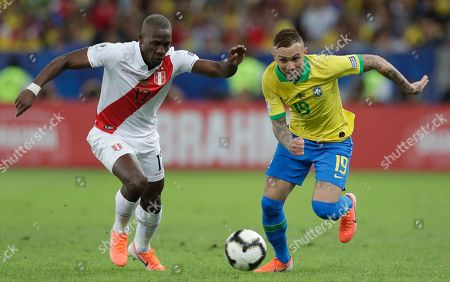 Peru's Luis Advincula, left, fights for the ball with Brazil's Everton during the final match of the Copa America at Maracana stadium in Rio de Janeiro, Brazil