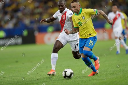 Peru's Luis Advincula, left, and Brazil's Everton fight for the ball during the final match of the Copa America at Maracana stadium in Rio de Janeiro, Brazil