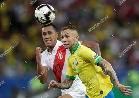Brazil's Everton, right, fights for the ball with Peru's Renato Tapia during the final match of the Copa America at Maracana stadium in Rio de Janeiro, Brazil