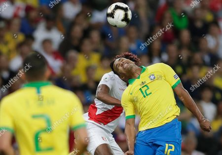Brazil's Alex Sandro, right, goes for a header with Peru's Andre Carrillo during the final match of the Copa America at Maracana stadium in Rio de Janeiro, Brazil