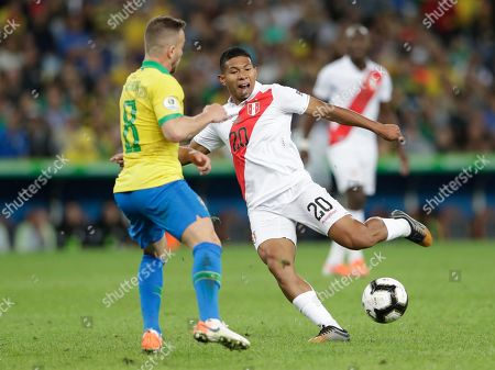 Peru's Edison Flores strike the ball in an attempt to score against Brazil during the final match of the Copa America at Maracana stadium in Rio de Janeiro, Brazil