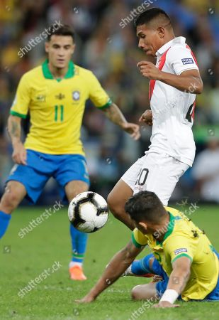 Stock Picture of Peru's Edison Flores controls the ball in an attempt to score against Brazil during the final match of the Copa America at Maracana stadium in Rio de Janeiro, Brazil