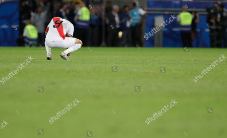 Peru's Paolo Guerrero crouches after his team was defeated 3-1 by Brazil in the final match of the Copa America at Maracana stadium in Rio de Janeiro, Brazil