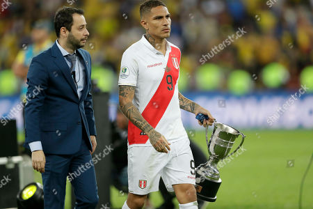 Peru's Paolo Guerrero walks with the second place trophy of the Copa America after Brazil defeated Peru 3-1in the final match of the Copa America at Maracana stadium in Rio de Janeiro, Brazil