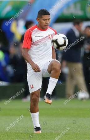 Peru's Edison Flores warms up prior the final match of the Copa America against Brazil at Maracana stadium in Rio de Janeiro, Brazil