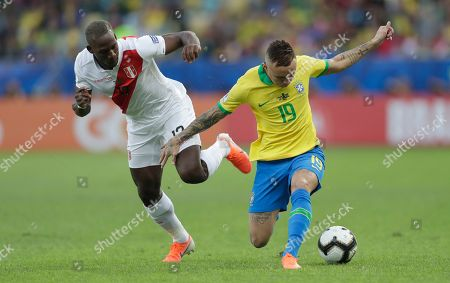 Peru's Luis Advincula fights for the ball with Brazil's Everton during the final match of the Copa America at Maracana stadium in Rio de Janeiro, Brazil