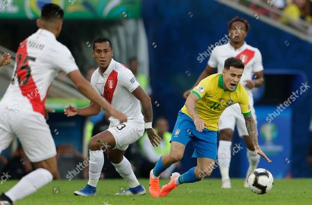 Brazil's Philippe Coutinho, right, is taken down by Peru's Renato Tapia during the final match of the Copa America at Maracana stadium in Rio de Janeiro, Brazil