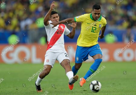 Peru's Edison Flores, left, fights for the ball with Brazil's Alex Sandro during the final match of the Copa America at Maracana stadium in Rio de Janeiro, Brazil