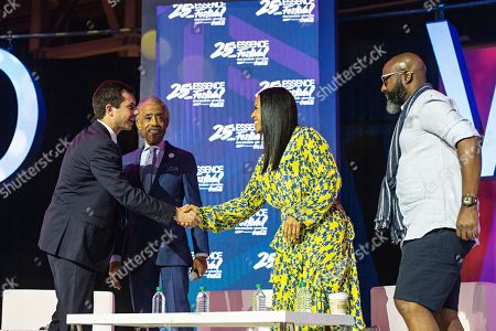 Pete Buttigieg; Al Sharpton; Michelle Ebanks; Richelieu Dennis. Democratic presidential candidate and South Bend, Ind. Mayor Pete Buttigieg, from left, Rev. Al Sharpton, Michelle Ebanks, and Richelieu Dennis attend the 2019 Essence Festival at the Ernest N. Morial Convention Center, in New Orleans