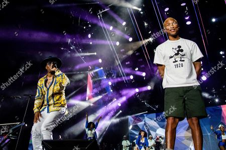 Pharrell Williams;Teddy Riley. Teddy Riley, left, and Pharrell Williams perform at the 2019 Essence Festival at the Mercedes-Benz Superdome, in New Orleans