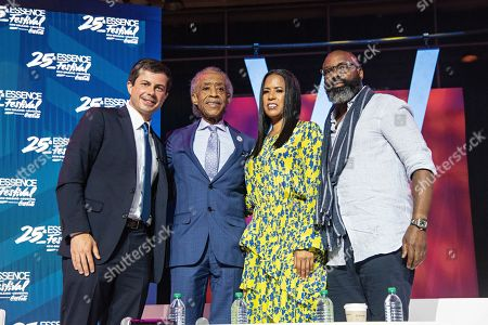 Stock Image of Pete Buttigieg; Al Sharpton; Michelle Ebanks; Richelieu Dennis. Democratic presidential candidate and South Bend, Ind. Mayor Pete Buttigieg, from left, Rev. Al Sharpton, Michelle Ebanks, and Richelieu Dennis attend the 2019 Essence Festival at the Ernest N. Morial Convention Center, in New Orleans