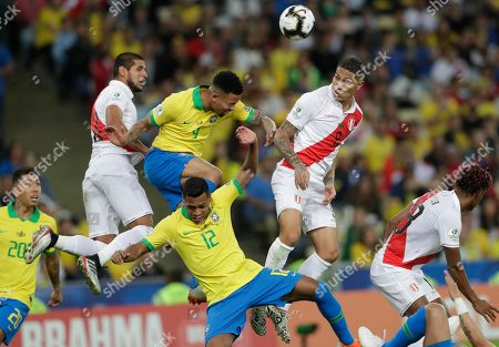 Brazil's Gabriel Jesus, center left, goes for a header with Peru's Paolo Guerrero, center right, during the final match of the Copa America at Maracana stadium in Rio de Janeiro, Brazil