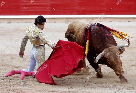 Spanish bullfighter Alberto Lopez Simon performs a pass on a bull during the bullfight of Pamplona's Bull Fair, in Pamplona, Navarra, Spain, 07 July 2019.