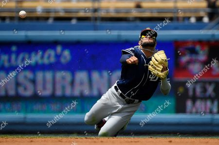 San Diego Padres shortstop Fernando Tatis Jr. throws out Los Angeles Dodgers' Austin Barnes during the second inning of a baseball game, in Los Angeles. Barnes was thrown out at first on the play